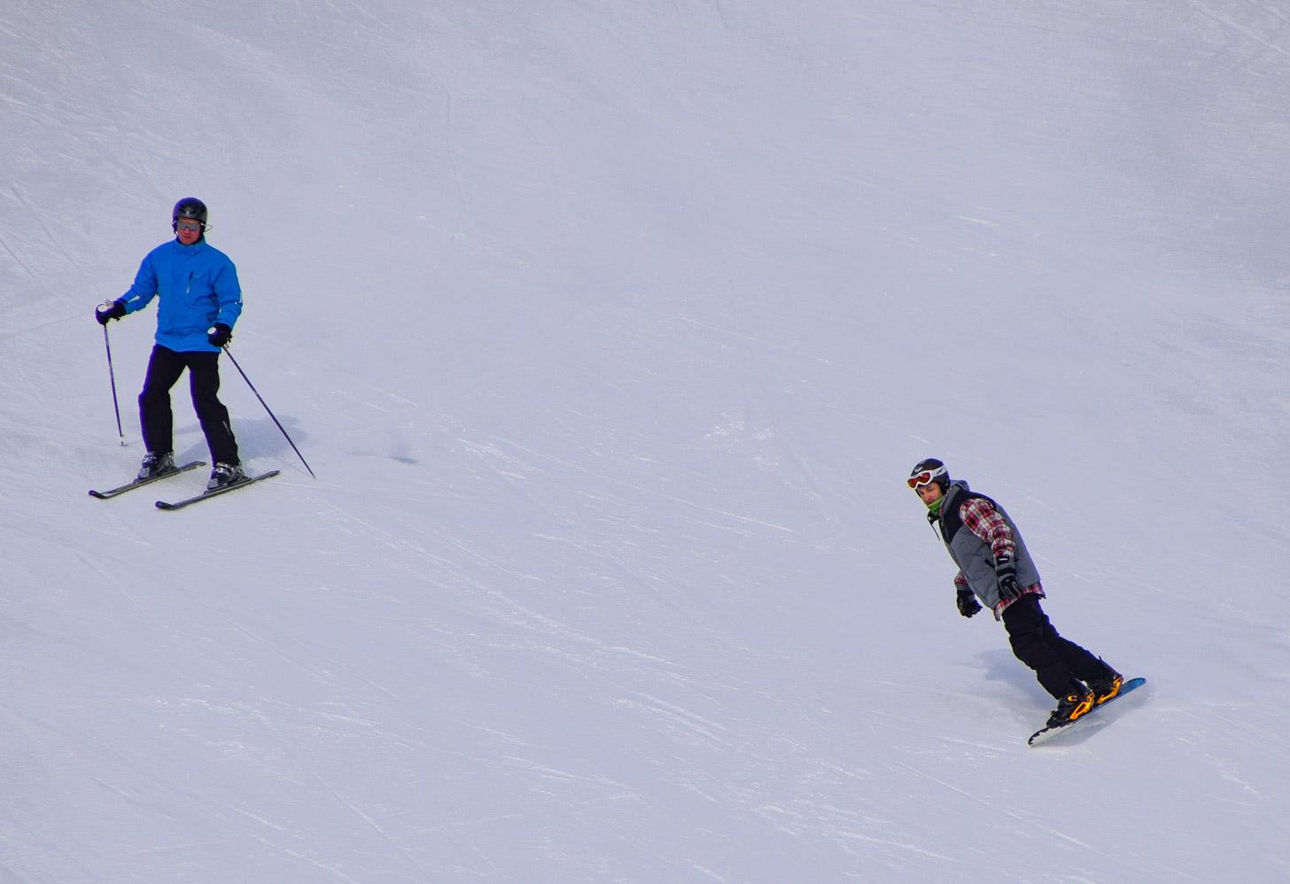Skiër en snowboarder
